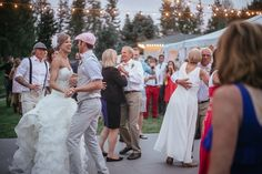 Matt Shumate Photography at The Ridge at Rivermere outdoor Wedding reception with white tent and lights Bride and Groom dancing with parents and guests having fun celebrating
