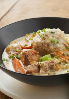Slow-Cooked Pork Stew with Dumplings – Homemade dumplings made with stuffing mix lend a savory surprise to this warm and creamy slow-cooker pork stew.