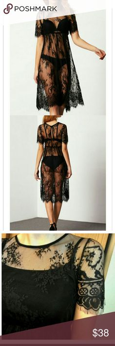 Black Lace Beach or Layering Dress Soft lace midi coverage for a day on the beach or a top layer over black slip.  I also wear mine as sexy lingerie or over skinny jeans and black crop top. Extremely versatile.  Available in Medium (bust: 36 waist: 28 length: 41 sleeves: 11) and Large (bust:38 waist: 30 length: 42 sleeves:). True to size. Waist elasticized  NWOT. Tops Tunics