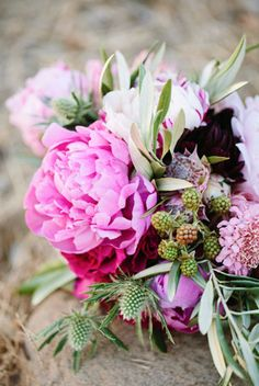Peony and rasberries. Floral decor on wooden table
