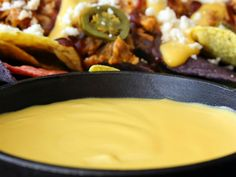 Pulled Pork Nachos with Homemade Cheddar Sauce (at Cooking Channel)