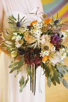 fall wedding bouquet, photo by Lara Kimmerer http://ruffledblog.com/fall-wedding-in-a-massachusetts-art-gallery #weddingbouquet #fallwedding