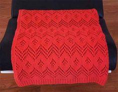 Красное покрывало, связанное спицами ажурным узором. Впрочем, цвет можно выбрать любой... Размер: 164 x 114 см Вам потребуется: 1000 г пряжи Cotofine (70% хлопка, 30% полиамида, 90 м/50 г) цвета омар…