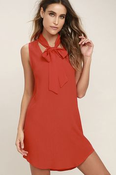 """Give yourself a whole new outlook, or just a new """"look"""" with the Lucy Love Start Fresh Red Shift Dress! A tying neck and front cutout top this sleeveless shift dress composed of light and gauzy woven fabric. Rounded hem."""