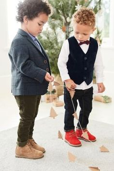 HOW adorable is this pair getting ready for their Christmas party?! Whether a waistcoat and pop of red through the shoes, or suit jacket and boots, here are a couple of outfits they'd love to hit the party wearing.