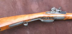 Upper East Tennessee Flintlock in curly Cherry custom made by D.K. Lisle. .40 Caliber with a curly Black Cherry Stock.