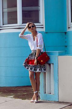Zanita blogger Zanita Whittington wears a miniskirt and a dress shirt for a fun summer look. // #Fashion