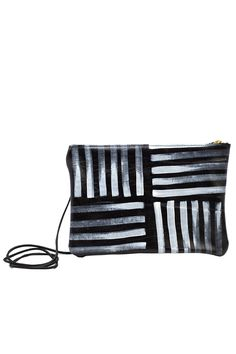This convertible clutch is hand-painted black leather with a removable crossbody strap. The unique smudge pattern is hand painted onto leather with an artist's brush so each bag is unique! Dimensions: