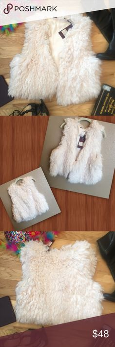 H. R. Pufnstuf So Soft and fluffy you'll want to pet yourself. Add an eye catching flare to your outfit with this creamy vest. One hook top for closure. 100% polyester. Bring to life that dreary dress or simple skirt with some fluff. Perfect with jeans to add a trendy look.  Feel pleasure throughout your day adding this simple versatile piece. Chelsea & Violet Jackets & Coats Vests