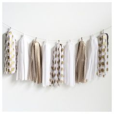 Golden Tassel Garland  Decorate your special event with a fabulous tassel garland. Tassel Garlands are the newest party decor trend and compliment any theme beautifully.