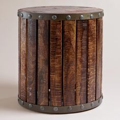 Our Wood Plank Drum Table is a unique accent table with an industrial style that suits any design décor. Each table is authentically handcrafted by artisans in India. Hand-fired mango wood planks create a sturdy base around its durable iron frame for a real statement piece. An iron frame in a distressed zinc finish and large rivet details completes its handmade appeal.