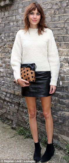 Alexa Chung.. Topshop sweater.. leather mini skirt, ankle boots.. Burberry clutch. . Erdem Spring Summer 2014 show.. LFW..