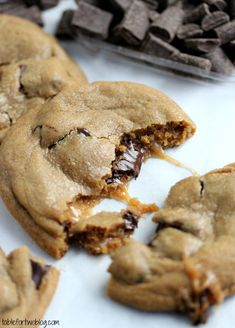 Caramel Stuffed Chocolate Chunk Cookies-If you replace baking powder with cornstarch (1:1 so 1 tsp of baking powder = 1 tsp cornstarch), you'll get super soft cookies!!