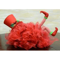 "making a wreath with elf legs | 12"" Pair Of Plush Elf Legs: Red & White Stripe"