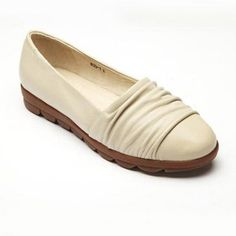 This all leather flat features generous folds of soft butter leather that comforts your toes and a half inch ribbed rubber sole with a slight rise to 1 inch at the heel. This shoe is all about providing a trendy look, while offering sole-technology that provides all day comfort and energy. The gentle rise propels you forward while the comfort ribs located in the sole help to reduce muscle fatigue and make wearing them a joy!