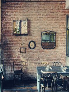 cafe design with character/embracing the imperfections - exposed brick and mismatched chairs (Rabbit Hole in Brooklyn)