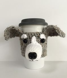 Make this cute crochet mug cozy with Lion Brand Vanna's Choice! Perfect for Whippet lovers - get the pattern by Angela Doherty aka HookedbyAngel (paid pattern).