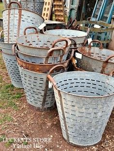 antique olive baskets (metal) at Lucketts Store ( I got one of these for my 60th birthday presents, I lined it with burlap and planted summer flowers--it is amazing--my sweet niece ( Annie) bought it for me !