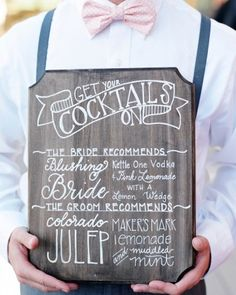 "A wooden menu outlining his-and-hers cocktails: a ""Colorado Julep"" and a ""Blushing Bride"""