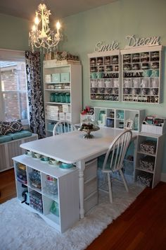 Island, window seat, black, white teal, organized craft room, with lots of work space