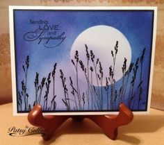 """By Patsy Collins. Stamp image in black VersaFine ink. Mask moon with a punched or die-cut circle. Sponge sky with Memento Blue Danube, Paris Dusk, & Lulu Lavender, creating dark & light areas. Remove mask. Drag sponge lightly across the moon to give the effect of clouds. [CASE of card by Doreen.] Grass stamp is """"Whispering Winds"""" by Inkylicious. Sentiment from """"Love and Sympathy"""" by Stampin' Up."""