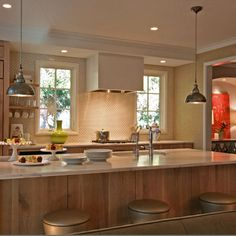 One of my favorite kitchens. Love this cabinetry and the white.