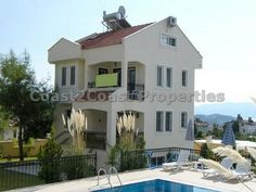 Large 5 bedroom FULLY FURNISHED detached villa with large shared pool offering great sea views.