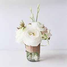 #tthblooms....plain. simple. with a long sprig, one tendril, and raw brown paper