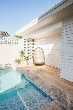 Hanging chair by the swimming pool is the best way to spend your weekend. The tiles and Miami bricks bring some colour and elegance to the overall style of the patio.