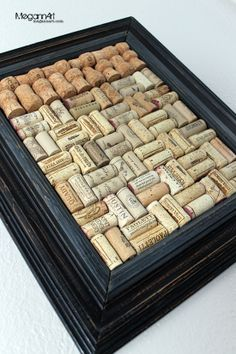 Repurpose corks and an old frame into memories of drinking/celebrating past.
