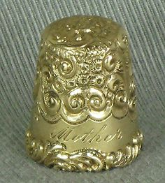 antique thimble dated 12-25-10
