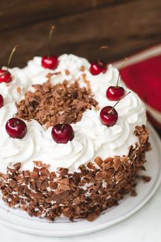 Easy black forest cake recipe made of 4 layers of moist chocolate cake, cherries, and whipped cream. It's super moist and flavorful!