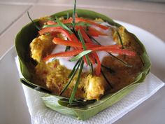Fish Amok is a classic Khmer dish, and everyone we talked to had a family recipe. It's usually steamed and served in a banana leaf with a little coconut cream on top. Serve the amok with white or brown rice on the side and a sprinkling of julienned red bell pepper and kaffir lime leaf ribbons. http://www.thecitykitchensf.com/about/