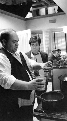 Peter Clemenza (Richard Castellano) and Michael Corleone (Al Pacino) in The Godfather (1972)