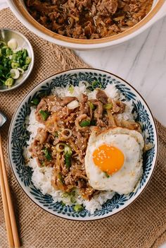 Gyudon (Japanese Beef and Rice Bowl) Recipe by the Woks of Life Japanese Gyudon, thinly sliced fatty beef cooked in a slightly sweet mixture of mirin and soy sauce served over rice. Topped with an egg, Gyudon is the best! Asian Recipes, Beef Recipes, Cooking Recipes, Healthy Recipes, Budget Recipes, Healthy Japanese Recipes, Rice Recipes, Easy Filipino Recipes, Healthy Food