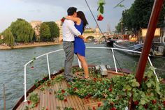 A romantic Paris proposal on the Seine while being showered in roses-- for real! Click here to read more! #Destination42 #DestinationWedding #DestinationProposal #Paris #France #CityofLights #amour #love #wedding #proposal #IDo #EiffelTower #JeTaime #fashion #light