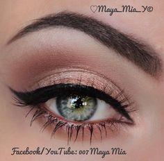 Subtle peach/nude eyeshadow with black liquid winged eyeliner. Simple yet Classy.
