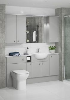 Pearl Grey is such a fantastic modern finish and is so on-trend. You can create a stylish look whilst maximising storage and the light tones of this versatile finish enhance the feeling of space in a bathroom. Fitted Bathroom Furniture, Small Bathroom Interior, Bathroom Design Luxury, Bathroom Layout, Bathroom Ideas, Small Grey Bathrooms, Bathroom Vanity Units, Compact Bathroom, Bathroom Designs