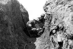 Signals troops using a field set in a trench