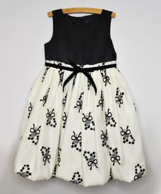 This Black Floral Garland Bow Dress - Toddler & Girls by Princess Faith is perfect! #zulilyfinds