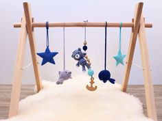 A personal favorite from my Etsy shop https://www.etsy.com/listing/516096666/nautical-baby-gym-wooden-baby-gym-with