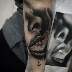 Tattoo of a woman exhaling smoke love it