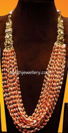 22 Carat gold multi strand coral beads long necklace with antique nakshi side billalu studded with polkis, rubies and emeralds by Manchukonda's Shyam Zaveri jewellers. Amrapali Jewellery, Bead Jewellery, Designer Jewellery, Gems Jewelry, Fashion Jewellery, Handmade Jewellery, Jewlery, Beaded Jewelry Designs, Gold Earrings Designs