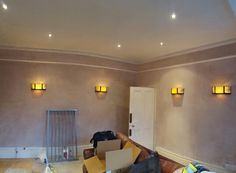 Ponari Builders Plastering Walls and install wall lighting in Muswell Hill, London