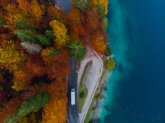 Car drive on road in autumn forest by lake, aerial view. Wallpaper Backgrounds, Wallpapers, Clear Lake, Autumn Forest, Drone Photography, Aerial View, Italy, River, Car
