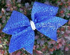 Custom Sequin Cheer Bows for your team! Many colors available.  Very pretty under the lights! By Two Tiara's Bowtique on Etsy or Facebook group. Team discounts are always available.  Etsy listing at https://www.etsy.com/listing/188712914/custom-sequin-cheer-bow-team-discounts