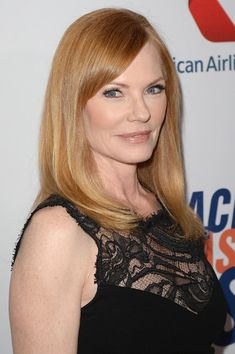 Marg Helgenberger Long Straight Cut with Bangs - Marg Helgenberger's strawberry locks looked nothing short of gorgeous when styled into a simple but elegant straight 'do.