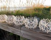 Beach wedding decor, place tealight candles inside and randomly place on the beach, or create an aisle out of these!  could also use shells!