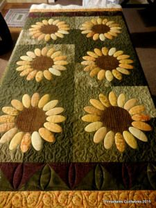 What a happy quilt finished with Superior Threads OMNI poly-core poly-wrapped thread!