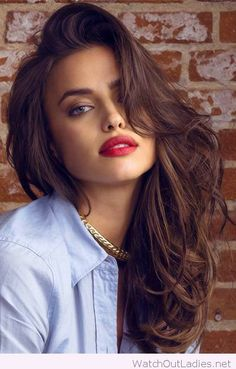 Red lipstick on a brunette, nice eye makeup